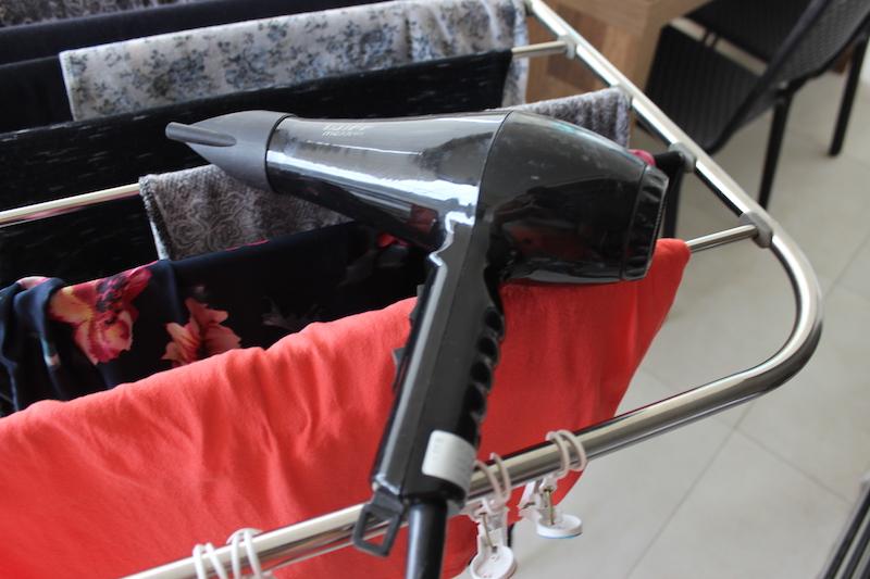 secador de cabelo para secar roupas