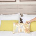 11 formas de posicionar almofadas e travesseiros na cama